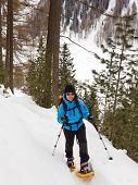 Young Woman Snowshoeing In South Tyrol