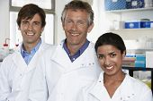 Multiethnic team of scientists smiling in laboratory