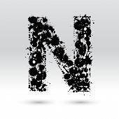 Letra N formado por manchas de tinta