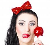 Sweet Pin-up Girl Eating A Candy Toffee Apple