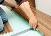 Man Laying Parquet In Clean Room