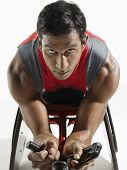 Closeup portrait of a paraplegic cycler against white background