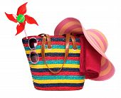 Colorful Striped Beach Bag With A Straw Hat Towel Sunglasses And A Windmill Toy