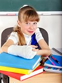 Child with broken arm in classroom.