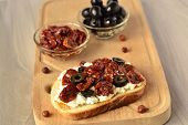 Toast with olives sun-dried tomatoes and cottage cheese