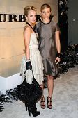 Mena Suvari and Amy Smart  at the Burberry Beverly Hills Store Re-Opening. Burberry Beverly Hills St