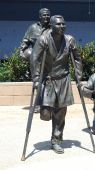 picture of amputee  - - This bronze sculpture depicts a patient from the 44th Field Hospital wearing a blue robe, freshly pinned with a purple heart. Close to 15,000 men in the U.S. Army, including Army Air forces underwent amputations during a 4-year period in the mi - JPG