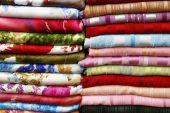 Pile Of Folded Fabrics And Shawls