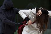 stock photo of stealing  - Woman attacked by a bandit who wants to steal her purse - JPG