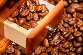 picture of wooden box from coffee mill  - Grains of black roasted coffee in drawer of mill - JPG