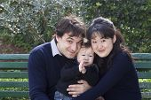 pic of nuclear family  - French father and Japanese mother with their baby boy in a park - JPG