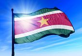 Suriname flag waving on the wind