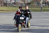 picture of tricycle  - Family on the tricycle at a park in spring - JPG
