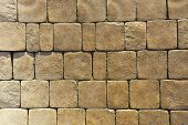 stock photo of cobblestone  - Pavement paved with light brown cobblestone in Yerevan - JPG