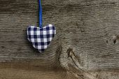 Blue Gingham Love Valentine's Heart Hanging On Wooden Texture Background