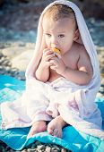 Cute Baby On The Sea Eating