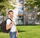 travel, vacation and education concept - travelling student with backpack and book