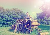 Handsome guy in Lederhosen posing outside in nature