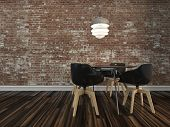 Small modern dining table and four chairs on a wooden parquet floor with rustic face brick wall in a