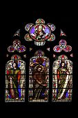 PARIS, FRANCE - NOV 11, 2012: Baptism of the Lord, stained glass from Church of St-Germain-l'Auxerro