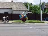 GOMEL, BELARUS - MAY 14, 2014: Rubik's Cube as a monument on a city street. Rubik's Cube is a 3-D co