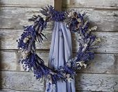 Lavender Wreath on old wooden wall