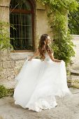 Beautiful Bride Walking At Wedding Day, Woman In Wedding Dress Outdoors.
