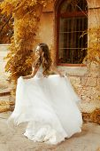 Beautiful Bride Woman In White Wedding Dress Running At Autumn Park