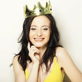 happy young lovely woman with crown
