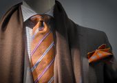 Grey Jacket With Brown Scarf, Orange Tie And Handkerchief