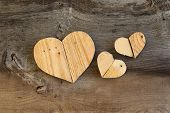 Three Love Valentines Wooden Hearts On Old Elm Background