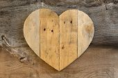 stock photo of elm  - Love Valentines wooden heart from recycled old palette on old grey Elm background copy space - JPG