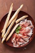 pic of antipasto  - prosciutto ham and grissini bread sticks - JPG