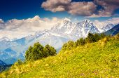 Majestic view of alpine meadows with blue sky at the foot of  Mt. Ushba. Upper Svaneti, Georgia, Europe. Caucasus mountains. Beauty world.