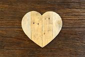 Love Valentines Wooden Heart On Rough Driftwood Background