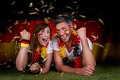 happy funny german couple rising arms
