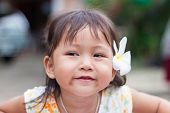 Portrait Of Little Asian Girl With Smile Face