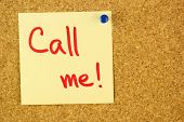 Yellow colorful call me sticker pined on the corkboard