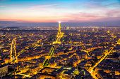 Paris - Jun 19: Aerial view of Eiffel Tower Light and Beam Performance Show at Dusk on Jun 19, 2014.