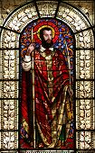 PARIS, FRANCE - NOV 10, 2012: Saint Dionysius, stained glass, Saint-Vincent-de-Paul Church (design J