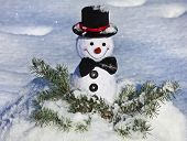 Happy Cheerful Christmas snowman in snow outdoors background