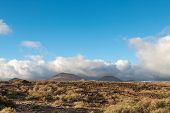 Arid landscape with volcanoes, in Timanfaya National Park, Lanzarote, Spain