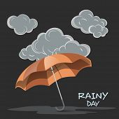 Rainy Day concept with open umbrella and black stormy clouds on grey background.