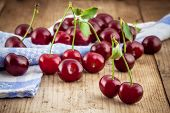 Ripe Cherry On Old Wooden Rustic Background