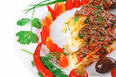 cannelloni in yellow cheese served with pepper and tomato