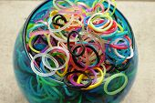 Pot of multicolored loom bands