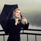 Young fashion woman with umbrella outdoor