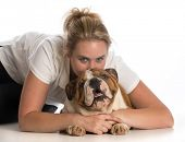 woman hugging english bulldog puppy