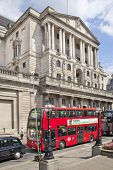 LONDON, UK - JUNE 30, 2014: Bank of England building. Busy road in front of bank with double red bus