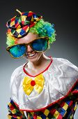 Funny clown with giant sunglasses